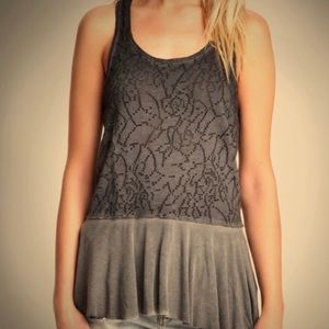 Free People distressed peplum tank L could fit M